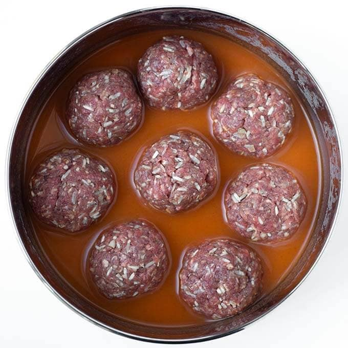 Instant Pot Porcupine Meatballs are a tasty and fun meal that kids and adults like! Cooked in your electric pressure cooker, these porcupine meatballs are done in minutes! simplyhappyfoodie.com #instantpotrecipes #instantpotporcupinemeatballs #instapot #instantpotmeatballs