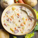 Instant Pot Potato Ham Soup in a beige bowl with veggies