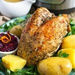 Cook a turkey breast and potato dinner in your Instant Pot, complete with gravy! Instant Pot Turkey Breast Potato Dinner is a one pot meal suitable for Thanksgiving or any time! simplyhappyfoodie.com #instantpotrecipes #instantpotturkeybreast #instapotturkey