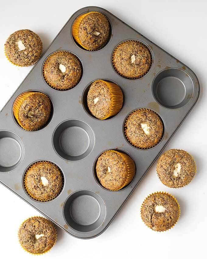 Orane Chocolate Cream Cheese Muffins are a delightful breakfast muffin. A nice chocolate orange muffin to have with tea or coffee. simplyhappyfoodie.com #muffins #orangechocolatemuffins #sweetmuffins #muffinswithcreamcheese
