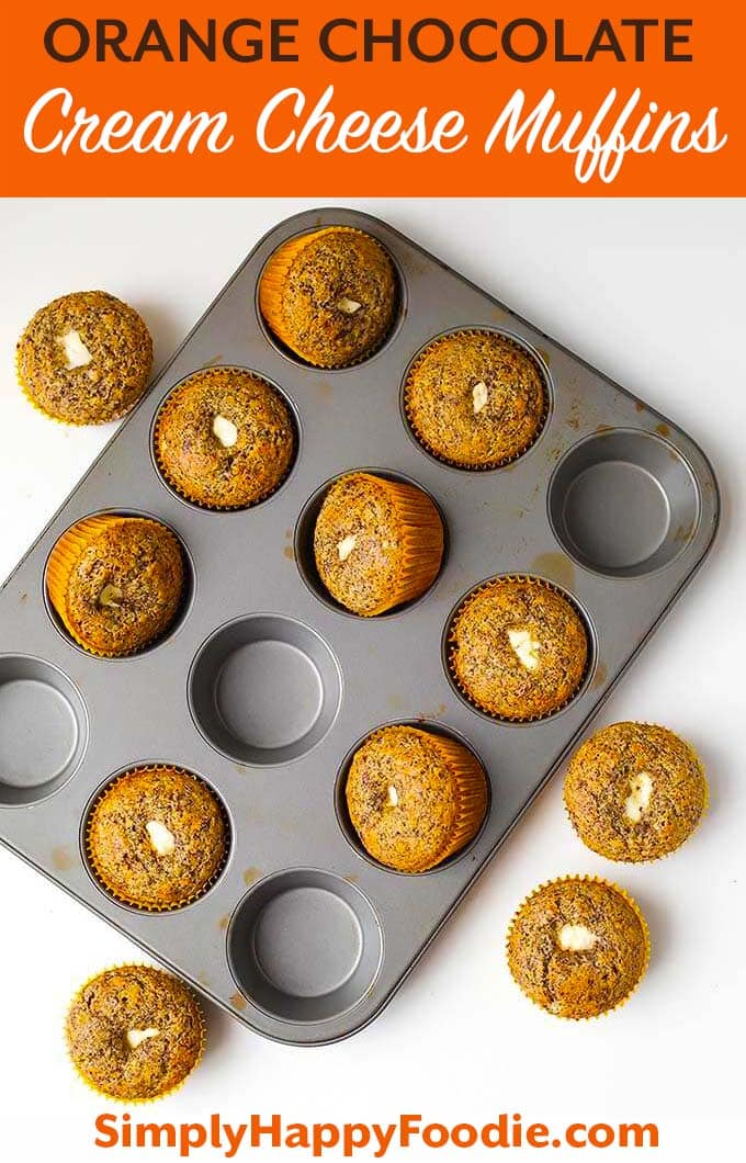 Orange Chocolate Cream Cheese Muffins are a delightful breakfast muffin. A nice chocolate orange muffin to have with tea or coffee. simplyhappyfoodie.com #muffins #orangechocolatemuffins #muffinswithcreamcheese