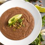 It's easy to make refried beans in your crock pot! Slow Cooker Refried Beans are flavorful, healthy, and taste much better than the canned stuff! simplyhappyfoodie.com #slowcookerrefriedbeans #crockpotrefriedbeans #slowcookerrecipes