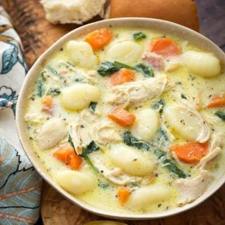 Instant Pot Creamy Chicken Gnocchi Soup is full of flavor from herb and spices, garlic, carrots, and bacon. Make this pressure cooker chicken gnocchi soup on a chilly day! Olive Garden copycat soup by simplyhappyfoodie.com #instantpotgnocchisoup #instantpotchickensoup