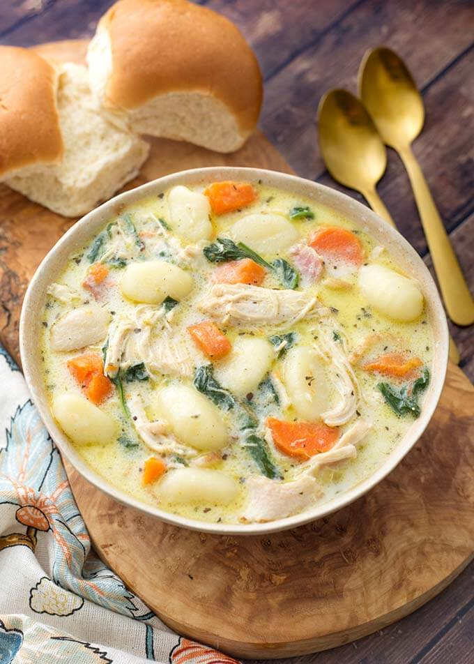Instant Pot Creamy Chicken Gnocchi Soup is so full of flavor from herb and spices, garlic, carrots, and bacon. Make this amazingly delicious pressure cooker chicken gnocchi soup on a cold day! Olive Garden copycat soup by simplyhappyfoodie.com #instantpotchickengnocchisoup #instantpotchickensoup