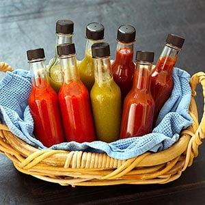 Make homemade hot sauce in your Instant Pot pressure cooker! Tasty and easy hot sauce recipe! simplyhappyfoodie.com #homemadehotsauce #hotsaucerecipe #instantpothotsauce
