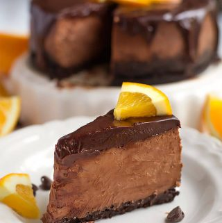 Instant Pot Chocolate Orange Cheesecake is rich and decadent. A great holiday cheesecake you make in your pressure cooker. simplyhappyfoodie.com #instantpotrecipes #instantpotcheesecake #instantpotchocolatechesecake