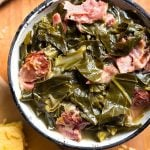 Rich, flavorful Instant Pot Collard Greens with a ham hock are so very good. You will love these pressure cooked collard greens with cornbread! simplyhappyfoodie.com #instantpotrecipes #instantpotcollards #instantpotcollardgreenshamhock