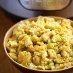 Instant Pot Cornbread Stuffing is the perfect Thanksgiving side dish. Fluffy cornbread flavored with sage and butter, and cooked in your electric pressure cooker. simplyhappyfoodie.com #instantpotrecipes #instantpotcornbread #instantpotcornbreadstuffing #instantpotcornbreaddressing #instantpotthanksgivingsidedish