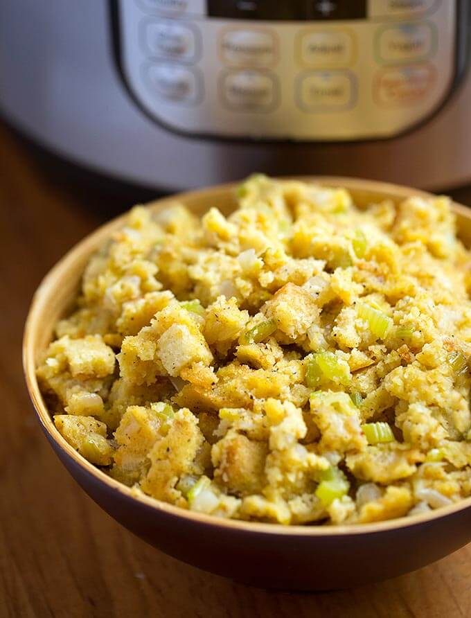 Instant Pot Cornbread Stuffing is the perfect Thanksgiving side dish. Fluffy cornbread flavored with sage and butter, and cooked in your electric pressure cooker. simplyhappyfoodie.com #instantpotcornbreadstuffing #instantpotcornbreaddressing
