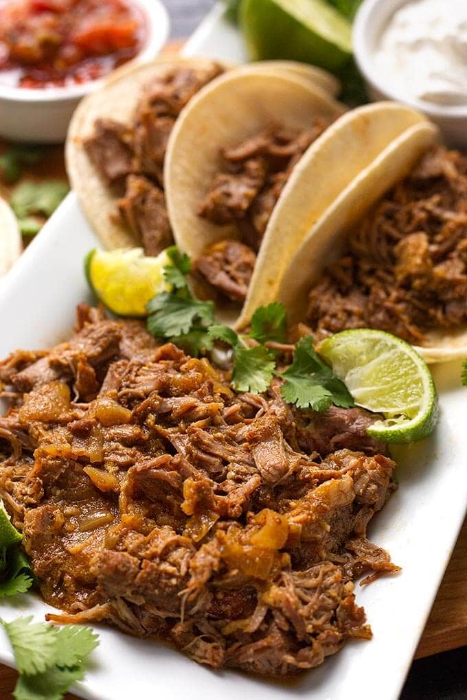 Instant Pot Mini - Pork Carnitas is a very flavorful meat seasoned with tasty Mexican spices. Use this versatile meat for tacos, burritos, sandwiches, and more. simplyhappyfoodie.com #instantpotrecipes #instantpotminirecipes #instantpotcarnitas #instantpot3quart #pressurecookercarnitas