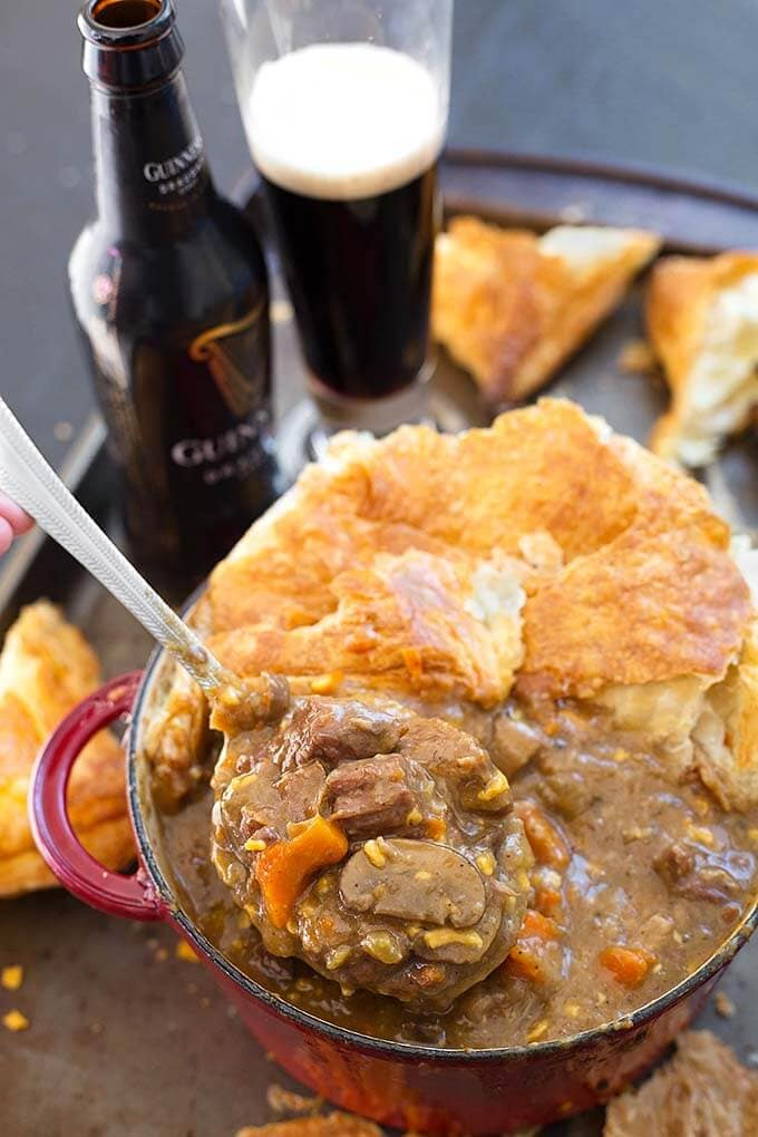 Instant Pot Beef Guinness Stew is rich, flavorful, and much faster to make in your electric pressure cooker than in the oven. A hearty and delicious beef stew. simplyhappyfoodie #instantpotrecipes #instantpotbeefstew #instantpotirishbeefstew #instantpotguinnessstew #pressurecookerbeefstew