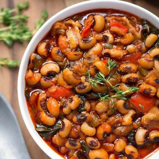 Instant Pot Black Eyed Peas is a delicious, traditional meal for New Year's. Make these Black Eyed Peas with collard greens in your pressure cooker. Quick cooking! simplyhappyfoodie.com #instantpotrecipes #instantpotblackeyedpeas #instantpotbeans #instantpotcollardgreens