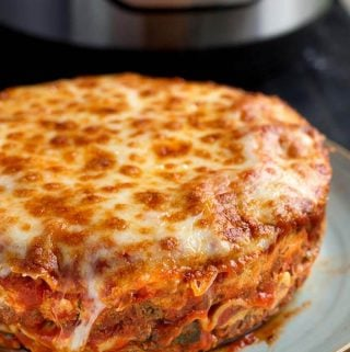 Instant Pot Lasagna is delicious and hearty. No need to pre-cook the pasta. Pressure cooker lasagna is easy to make. simplyhappyfoodie.com #instantpotrecipes #instantpotlasagna #pressurecookerlasagna