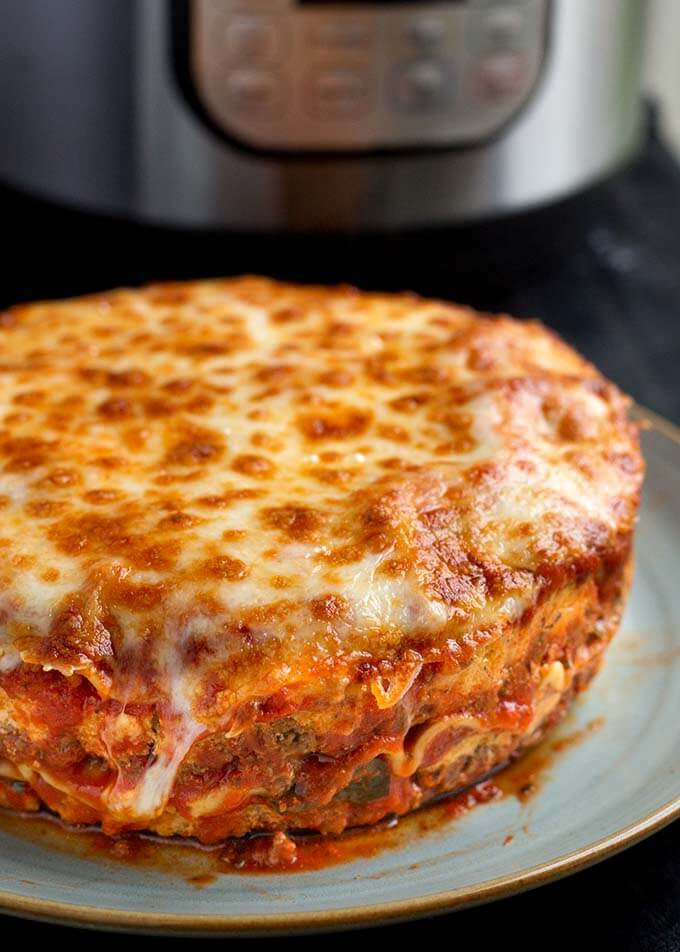 Instant Pot Lasagna is delicious and hearty. No need to pre-cook the pasta. Pressure cooker lasagna is easy to make. simplyhappyfoodie.com #instantpotlasagna #pressurecookerlasagna