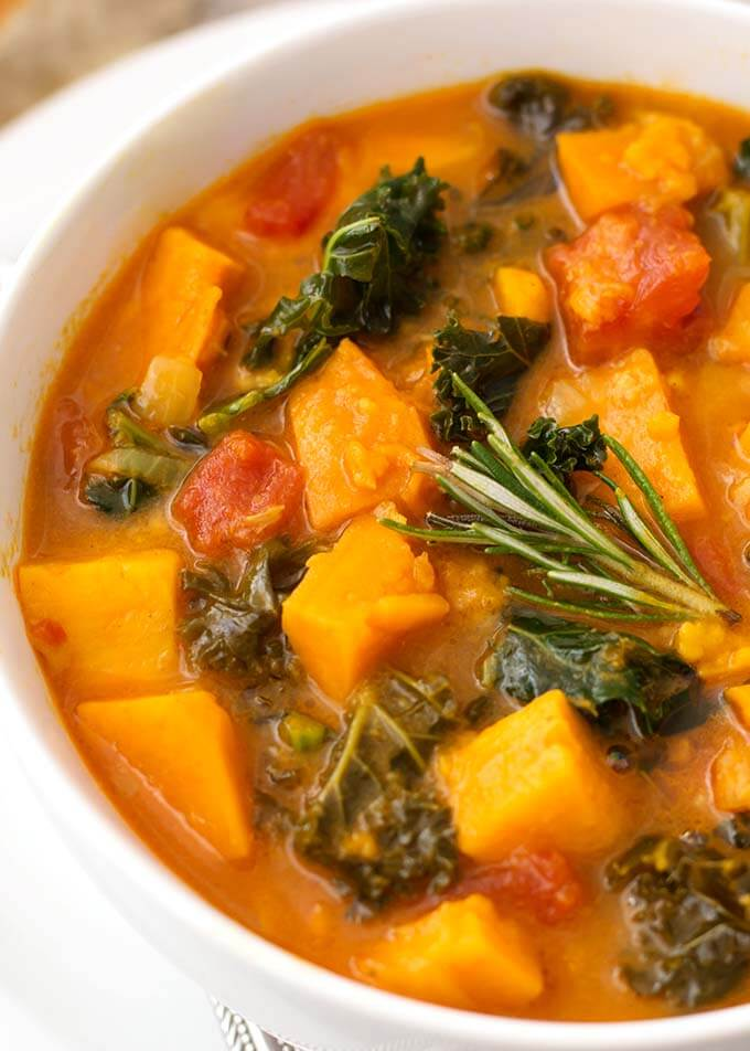 Instant Pot Sweet Potato and Kale Soup is a hearty, vegetarian and vegan soup with a ton of flavor. It is easy to make, and so very delicious, and very healthy! simplyhappyfoodie.com #instantpotrecipes #instantpotsweetpotatokalesoup #instantpotsoup #pressurecookersoup #instantpotvegan