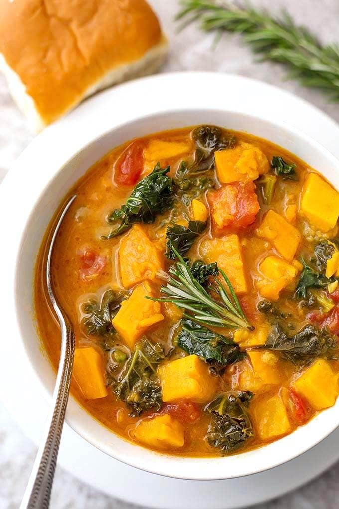 Instant Pot Sweet Potato and Kale Soup is a hearty, vegetarian and vegan soup with a ton of flavor. It is easy to make, and so very delicious, and a very healthy pressure cooker sweet potato kale soup! simplyhappyfoodie.com #instantpotsweetpotatokalesoup #pressurecookersoup