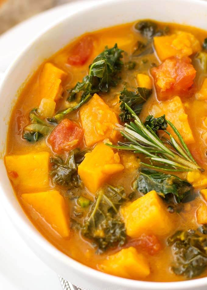 Instant Pot Sweet Potato Kale Soup is a hearty, vegetarian and vegan soup with a ton of flavor. It is easy to make, and so very delicious, and a very healthy pressure cooker sweet potato kale soup! simplyhappyfoodie.com #instantpotrecipes #instantpotsweetpotatokalesoup #instantpotsoup #pressurecookersoup #instantpotvegan