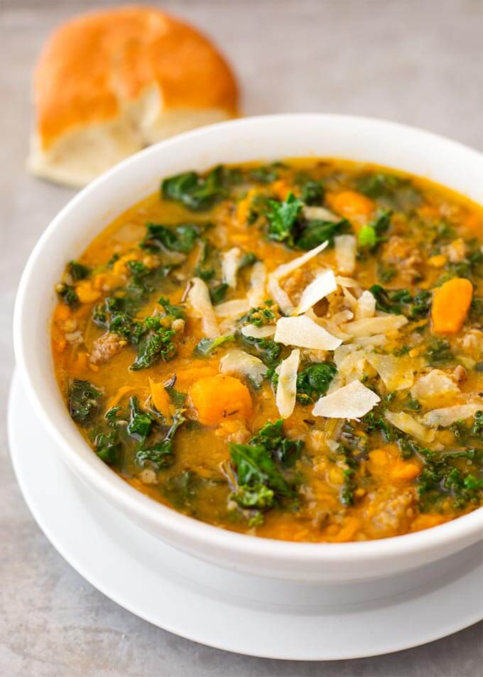 Instant Pot Sweet Potato Sausage and Kale Soup is a hearty, but not heavy soup with a ton of flavor. It is easy to make, and so very delicious, and even healthy! simplyhappyfoodie.com #instantpotsweetpotatosausagekalesoup #pressurecookersoup