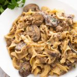Instant Pot Hamburger Stroganoff is a delicious, money saving variation of the favorite Beef Stroganoff. With a rich flavor, no 'cream of' soup needed, this pressure cooker stroganoff will become a family favorite! simplyhappyfoodie.com #instantpotrecipes #instantpotbeefstroganoff #instantpothamburgerstroganoff #pressurecookerstroganoff