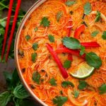 Instant Pot Red Curry Coconut Noodle Soup has amazing flavor. With red curry, chicken, and noodles, this pressure cooker red curry noodle soup is delicious and easy to make! simplyhappyfoodie.com #instantpotrecipes #instantpotredcurry #instantpotredcurrynoodles #pressurecookerredcurynoodlesoup