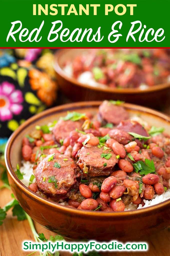 Instant Pot Red Beans and Rice with Sausage is a flavor packed, spicy New Orleans traditional meal. This pressure cooker Red Beans and Rice recipe has lots of flavor, and you can make it from dry beans in just over an hour! Instant Pot recipes by simplyhappyfoodie.com #instantpotredbeansandrice #pressurecookerredbeansandrice
