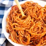 Instant Pot Spaghetti is a one pot spaghetti with meat sauce that turns out delicious, and is easy and quick to make. Pressure cooker spaghetti, who knew?! simplyhappyfoodie.com #instantpotrecipes #instantpotspaghetti #pressurecookerspaghetti