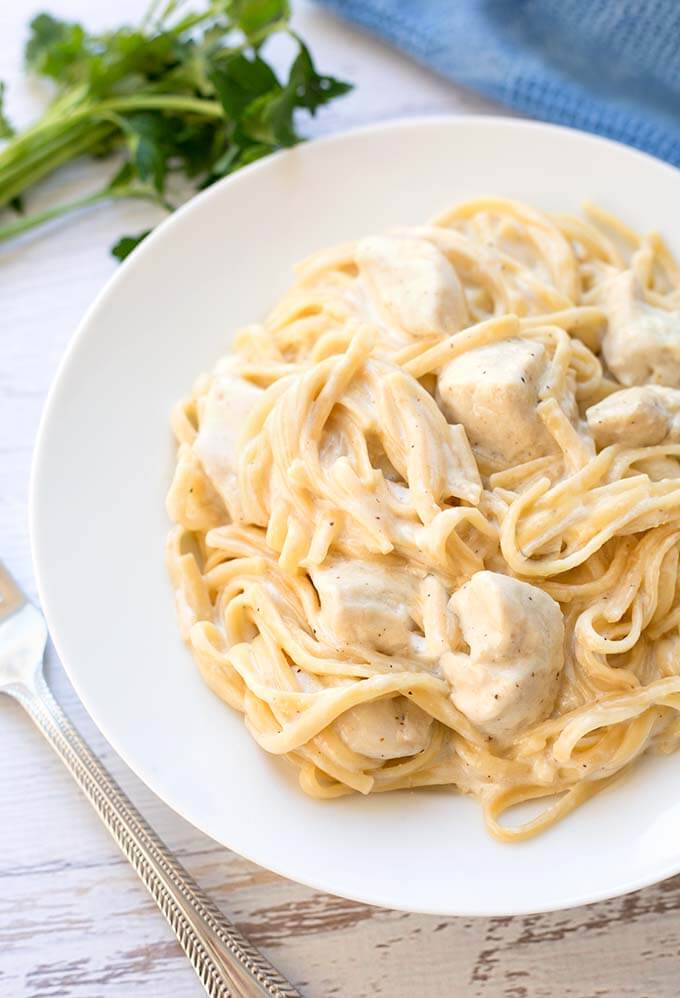 Instant Pot Fettuccine Alfredo with chicken, or without, is a one pot meal that you can dump and push start! It's a quick meal that any pasta lover will enjoy! Make this pressure cooker Fettuccine Alfredo for a yummy meal! simplyhappyfoodie.com #instantpotrecipes #instantpotfettuccinealfredo #instantpotpasta #pressurecookerfettuccine