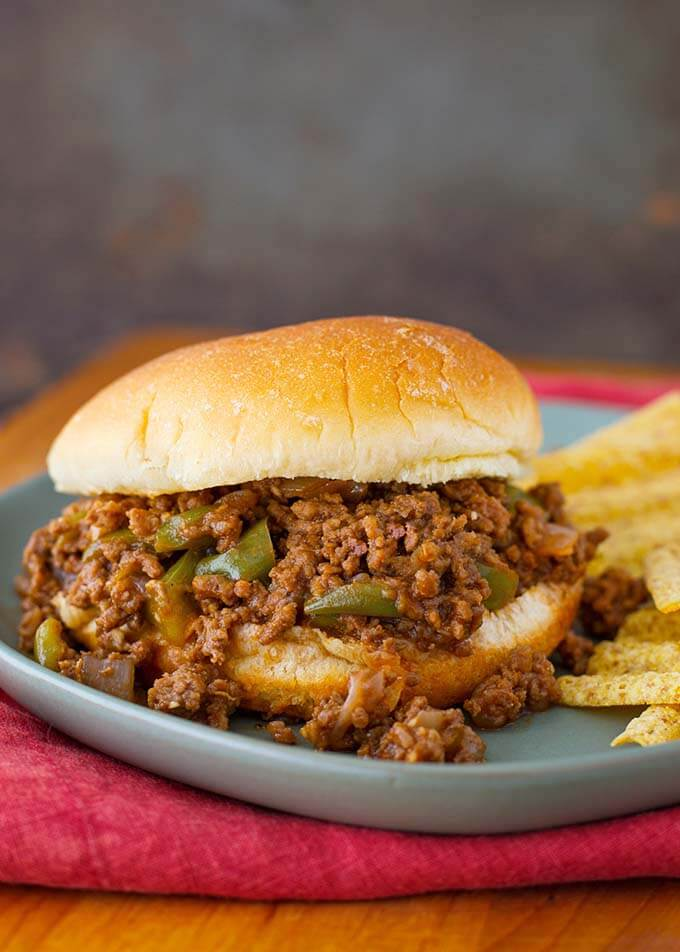 Instant Pot Sloppy Joes are tangy and a little sweet, with lots of flavor. Enjoy pressure cooker Sloppy Joes for a quick dinner. simplyhappyfoodie.com #instantpotsloppyjoes #pressurecookersloppyjoes #instantpotgroundbeefrecipes