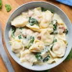 Instant Pot Tortellini Alfredo with chicken and spinach is so amazingly flavorful and rich. This is a tasty Instant Pot one-pot pasta meal. Make this pressure cooker Tortellini Alfredo when you want the best comfort food! simplyhappyfoodie.com #instantpotrecipes #instantpottortellinialfredo #instantpotchickenalfredo #pressurecookertortellinialfredo