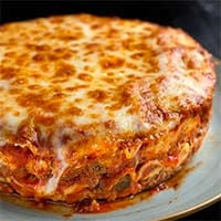 Round Instant Pot Lasagna on a gray plate