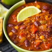 Instant Pot Chili in a green bowl topped with a slice of lime