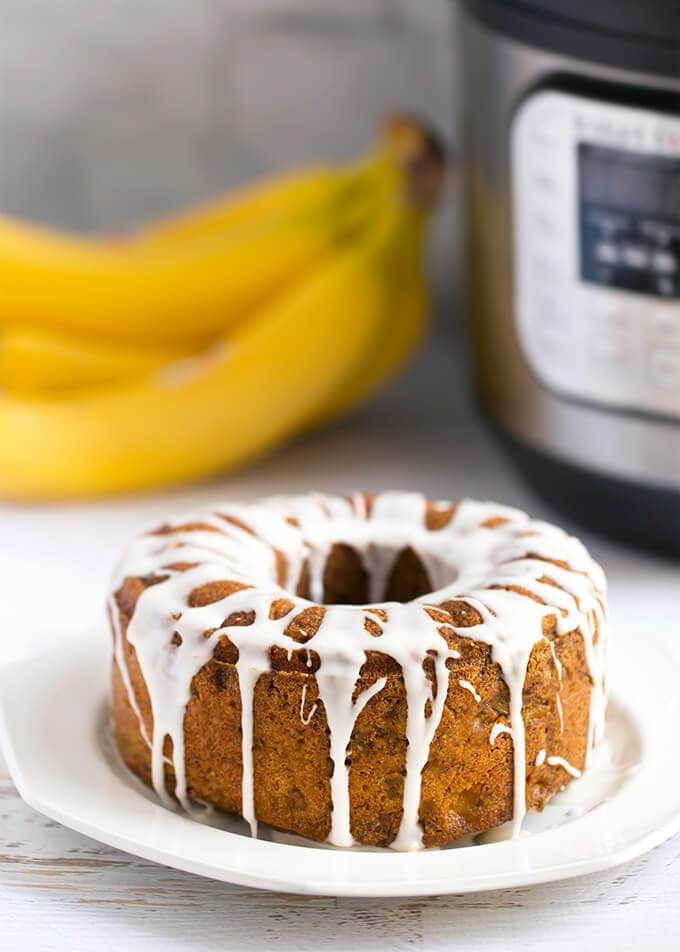 Instant Pot Banana Bread is sweet, tender, and so delicious. All you need is three ripe bananas, and you are on your way to a delicious banana bread. Pressure cooker banana bread is really easy to make and will bring memories of home. Instant Pot Recipes by simplyhappyfoodie.com #instantpotbananabread #pressurecookerbananabread