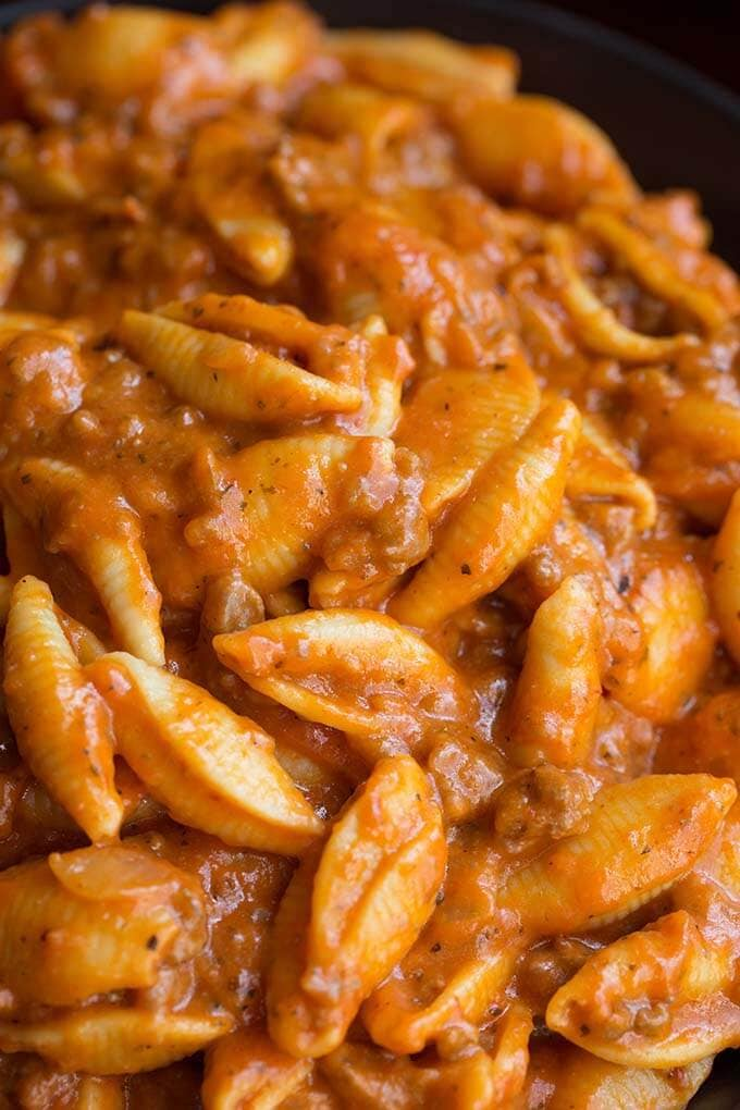 Instant Pot Cheesy Meaty Shells taste almost like a bowl of lasagna pasta! Rich tomato flavor makes the meat sauce delicious. Two kinds of cheese take this pressure cooker Italian pasta dish over the top! simplyhappyfoodie.com