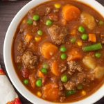 Instant Pot Hamburger Soup is a comforting classic ground beef stew made with simple, tasty ingredients. This pressure cooker hamburger soup is a family favorite! simplyhappyfoodie.com #instantpotrecipes #instantpothamburgersoup #instantpotsoup #pressurecookerhamburgersoup #instantpotgroundbeef