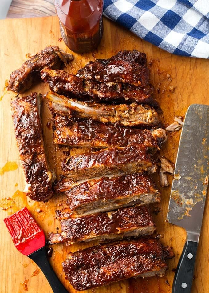 Instant Pot Baby Back Ribs are amazing, very tasty, and done in under an hour! These pressure cooker ribs are the best! simplyhappyfoodie.com #instantpotribs #pressurecookerribs