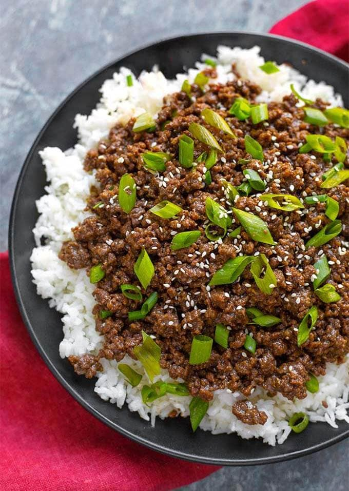 Instant Pot Korean Ground Beef - Bulgogi has incredible flavor! Use this amazing meat for Korean beef tacos, Korean beef rice bowl, or Korean beef lettuce wraps. This pressure cooker Korean ground beef is delicious, and so fast and easy. Make your rice at the same time! simplyhappyfoodie.com #instantpotrecipes #instantpotkoreanbeef #instantpotkoreangroundbeef #instantpotgroundbeef #pressurecookergroundbeef