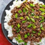 Korean Ground Beef - Bulgogi over white rice on a black plate