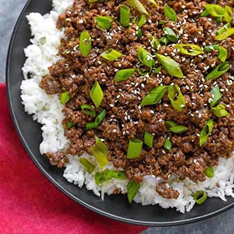Instant Pot Korean Ground Beef - Bulgogi has incredible flavor! Use this amazing meat for Korean beef tacos, Korean beef rice bowl, or Korean beef lettuce wraps. This pressure cooker Korean ground beef is delicious, and so fast and easy. Make your rice at the same time! simplyhappyfoodie.com #instantpotrecipes #instantpotkoreanbeef #instantpotkoreangroundbeef #instantpotgroundbeef #pressurecookergroundbee