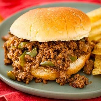 Instant Pot Sloppy Joes are tangy and a little sweet, with lots of flavor. Enjoy pressure cooker Sloppy Joes for a quick dinner. simplyhappyfoodie.com #instantpotrecipes #instantpotsloppyjoes #pressurecookersloppyjoes #instantpotgroundbeefrecipes
