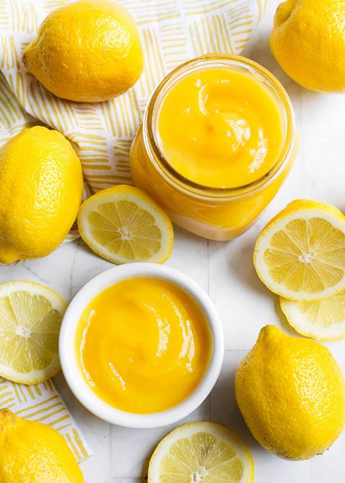 Instant Pot Lemon Curd is a delicious confection made with lemons, eggs, & butter. It's delicious on cheesecakes, pastries, yogurt, toast, and as a filling. Pressure cooker lemon curd is a tart-sweet treat! simplyhappyfoodie.com #instantpotrecipes #instantpotlemoncurd #instantpotdesserts #pressurecookerlemoncurd