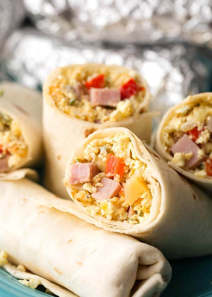 Instant Pot Breakfast Burritos are so good, and easy to make. You can customize these pressure cooker breakfast burritos any way you want. These delicious Instant Pot egg burritos are good for meal prep. simplyhappyfoodie.com instant pot recipes #instantpotrecipes #instantpotbreakfastburritos #pressurecookerbreakfastburritos