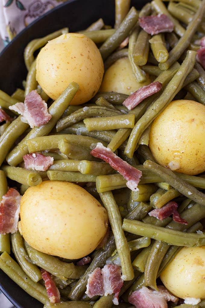 Closeup of Green Beans with New Potatoes and Bacon in a black bowl