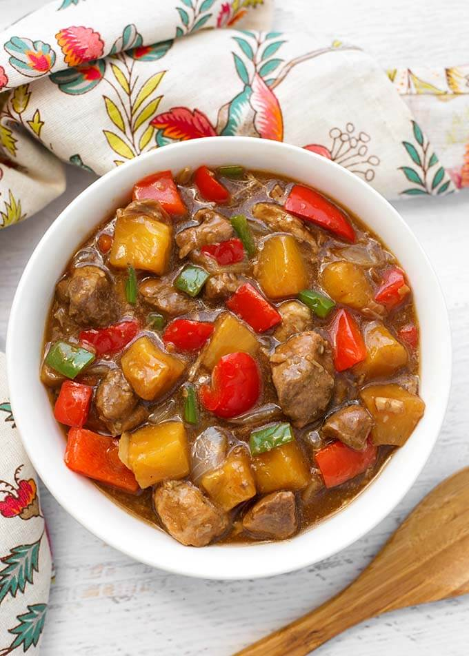 Instant Pot Hawaiian Pineapple Pork brings Hawaiian and Asian flavors to tender chunks of pork, with pineapple and red bell peppers. Pressure cooker Hawaiian Pineapple Pork over rice is so delicious! simplyhappyfoodie.com #instantpotrecipes #instantpothawaiianpork #instantpotpineapplepork #pressurecookerpineapplepork #pressurecookerhawaiianpork instant pot recipes