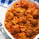 Instant Pot Spaghetti and Meatballs is a delicious one-pot meal. This pressure cooker spaghetti and meatballs is easy to make and is ready in under an hour. simplyhappyfoodie.com #instantpotspaghetti #instantpotspaghettiandmeatballs #pressurecookerspaghetti #pressurecookerspaghettiandmeatballs