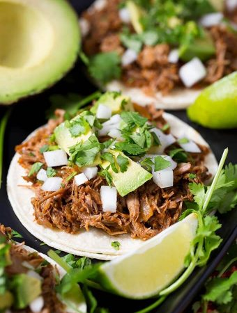 Slow Cooker Barbacoa Beef is a tender Mexican shredded beef that you can use in shredded beef tacos, and beef rice bowls. Crock Pot Barbacoa Beef is super flavorful and couldn't be easier to make! simplyhappyfoodie.com #slowcookerbarbacoabeef #crockpotbarbacoabeef #shreddedbeef easy slow cooker recipes, easy crock pot recipes