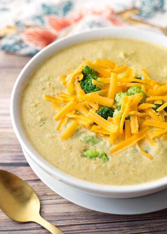 Slow Cooker Broccoli Cheddar Soup is delicious 'comfort food' soup made with broccoli, onion, cheese, & tasty seasonings. This Crock Pot Broccoli cheese Soup is a great family meal! simplyhappyfoodie.com #broccolicheesesoup #broccolicheddarsoup #crockpotsoup #slowcookersoup