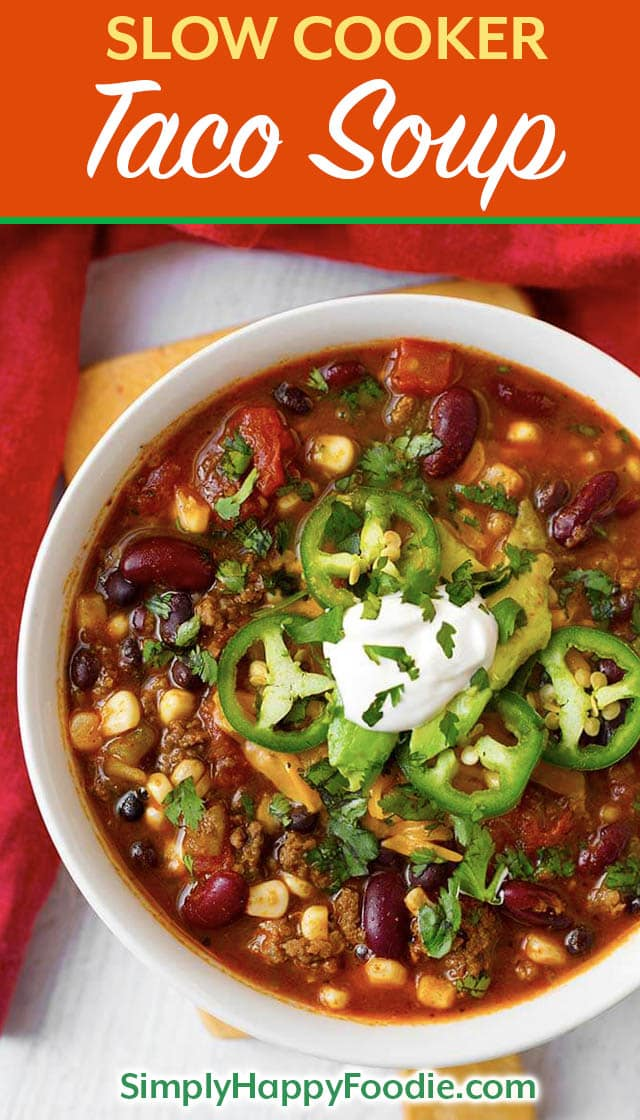 Slow Cooker Taco Soup is tasty Mexican soup that uses up some of the canned goods that are hanging out in your pantry. With beans, corn, ground beef or turkey, and some flavorings, you can easily make this delicious crock pot Taco Soup! simplyhappyfoodie.com #tacosoup #slowcookertacosoup #crockpottacosoup Crock Pot recipes and Slow cooker recipes