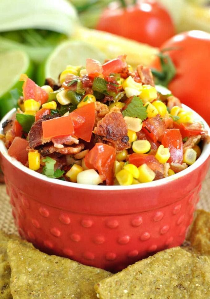 chipotle corn and bacon salsa in a red bowl