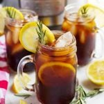 three glasses of iced tea on a table in front of a pressure cooker