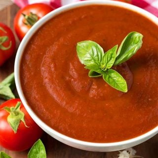 Marinara Fresh Tomato Sauce in a white bowl topped with fresh basil